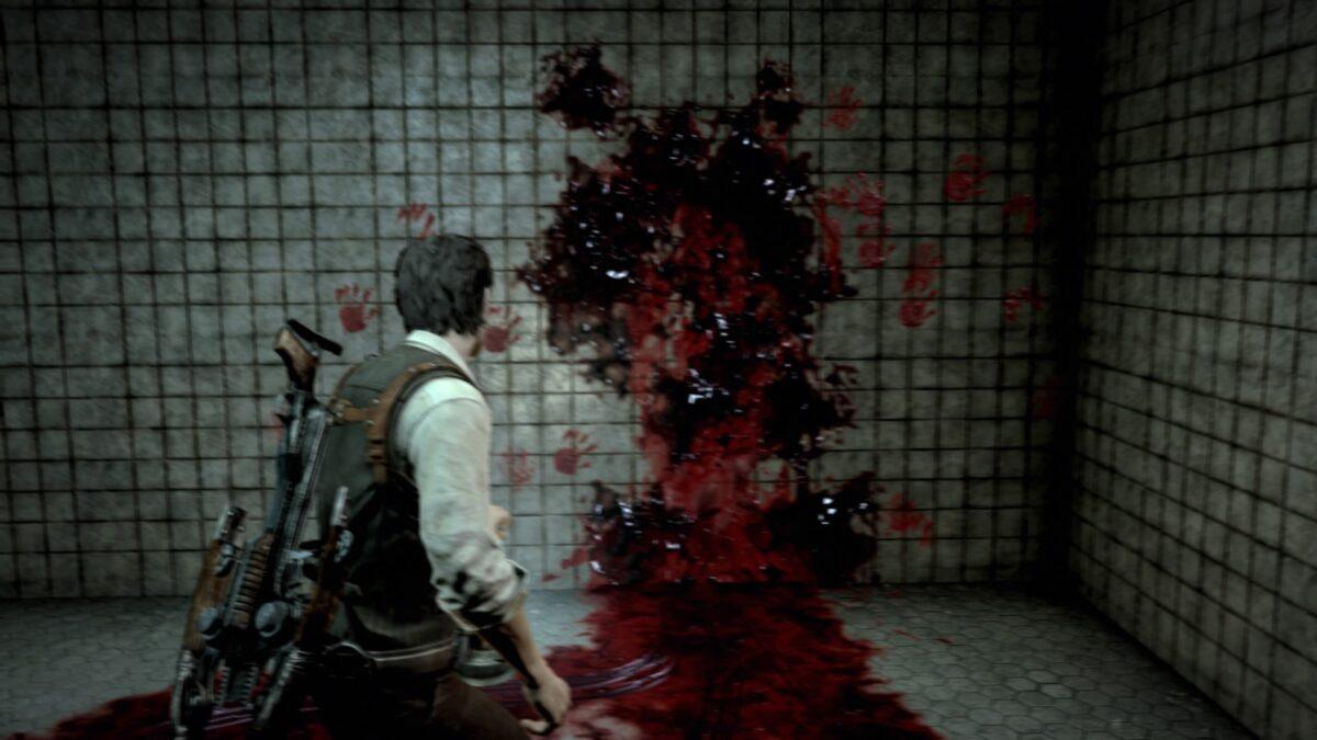 血の手形から扉が浮かび上がってくるシーン